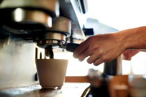 Cropped shot of a barista preparing coffeehttp://195.154.178.81/DATA/i_collage/pu/shoots/805179.jpg